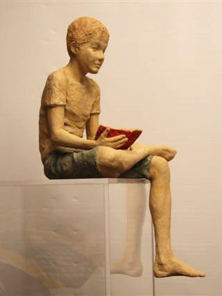 Child with the little red book ceramic 57x30x26